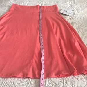 LuLaRoe Skirts - Coral mid level skirt, cozy, true to size
